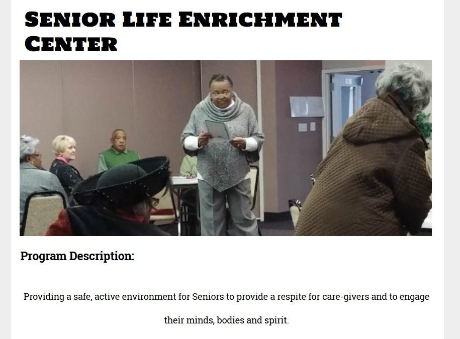 Woman presenting to seniors at Senior Life Enrichment Center